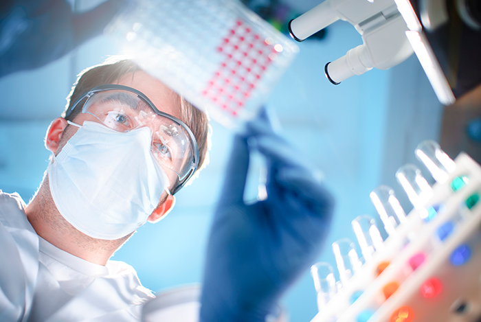 Photo of a male scientist working in the lab.